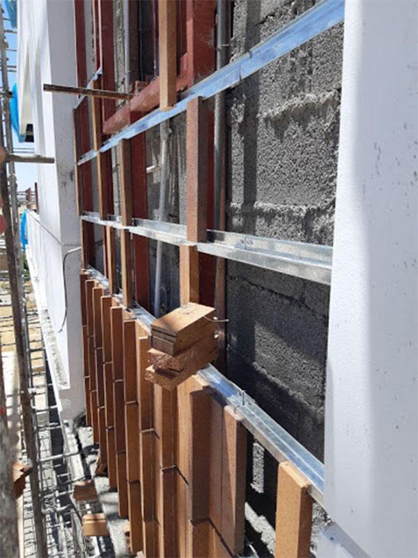 Execution of dry brick facade